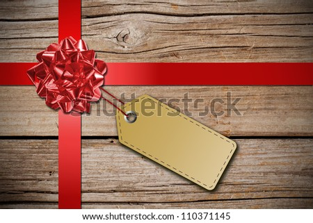 Blank tag on rustic wood - stock photo