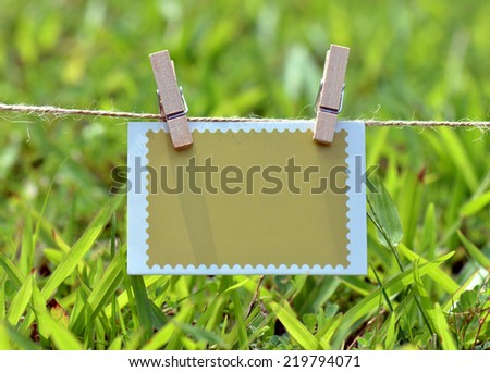 Blank tag on the rope with clothespins - stock photo