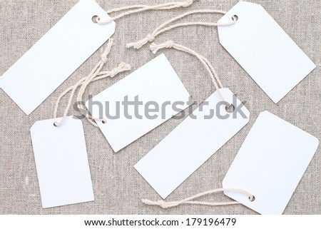 blank tag or label on burlap background - stock photo