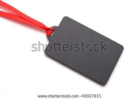 Blank tag tied with red ribbon with soft shadow. Price tag,gift tag,sale tag, address label,etc. - stock photo