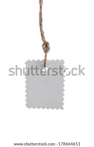 Blank tag tied with string. Price tag, gift tag, sale tag, address label. Isolated on a white background. - stock photo