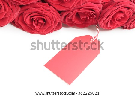 Blank tag with red roses isolated on white background - stock photo