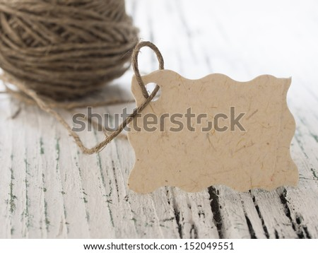 blank tag with string on the white table - stock photo