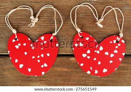 Blank tags on wooden background - stock photo
