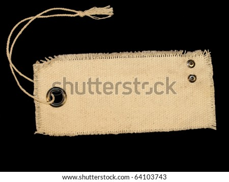 Blank textile tag isolated on black background - stock photo
