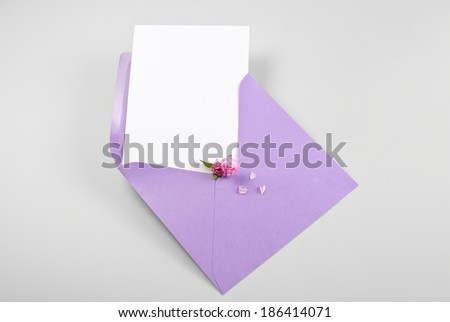 Blank thank you or greeting card in envelope with spring flowers  - stock photo