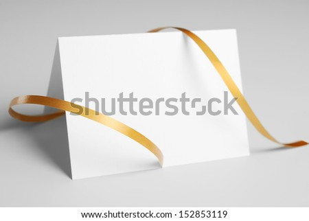 Blank thank you or greeting card with golden ribbon - stock photo