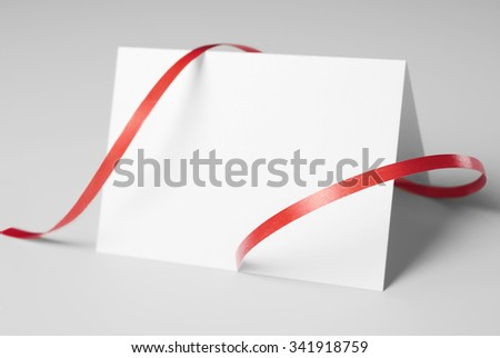 Blank thank you or greeting card with red ribbon