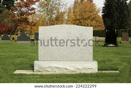Blank Tombstone in colorful cemetery - stock photo