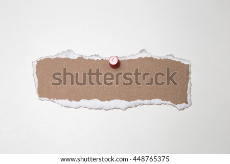 Blank torn brown paper with red push pin. isolated on white - stock photo