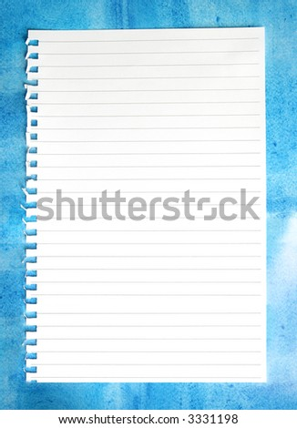 Blank torn notepaper on a mottled blue background. - stock photo