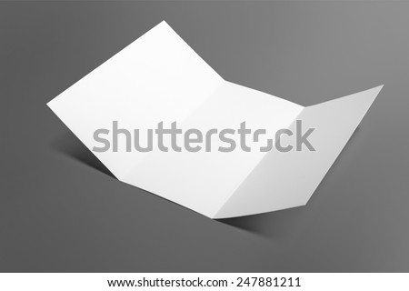 Blank tri fold brochure isolated on grey to replace your design - stock photo