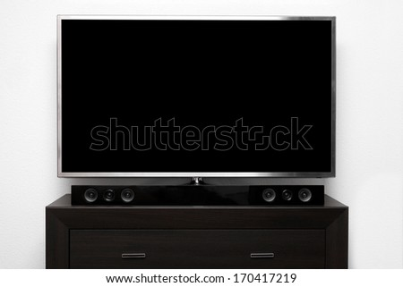 blank tv with stereo system on brown commode