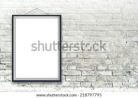 Blank vertical painting poster in black frame hanging on white brick wall. Painting proportions match international paper size A. - stock photo