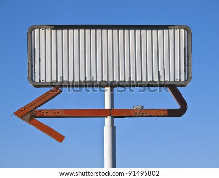 Blank vintage arrow sign in early morning light. - stock photo