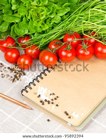 blank vintage cooking notebook with tomatoes, chives and spices