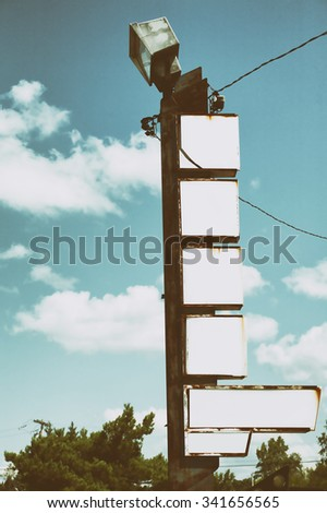 Blank vintage hotel sign complete with rust and wires. - stock photo