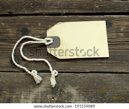 Blank vintage label on old wooden boards - stock photo