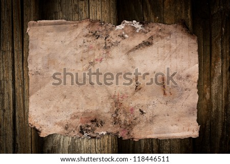 Blank vintage paper sheet on a dark wooden background - stock photo