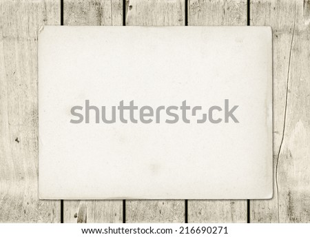 Blank vintage paper sheet on a white wood board panel - stock photo