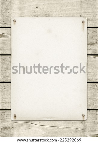 Blank vintage poster nailed on a white wood board panel - stock photo