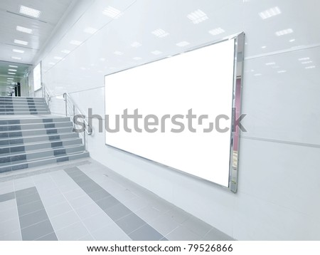Blank wall and staircase in underground - stock photo