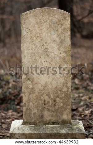 Blank weathered tombstone. Includes clipping path for the tombstone. - stock photo