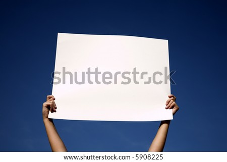 Blank white banner hold up in the air, isolated against deep blue sky