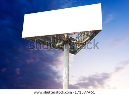 Blank white billboard against blue sky, put your own text here - stock photo