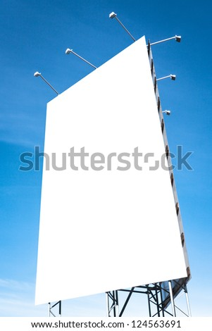 blank white billboard in front of blue sky - stock photo