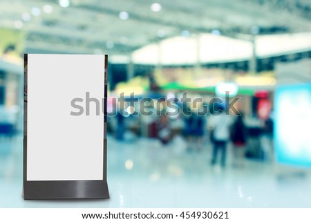 blank white billboard in the shopping center,blur background - stock photo