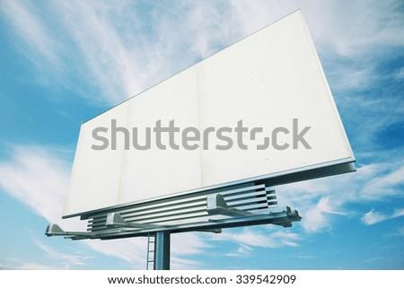 Blank white billboard on a background of blue sky, mock up - stock photo