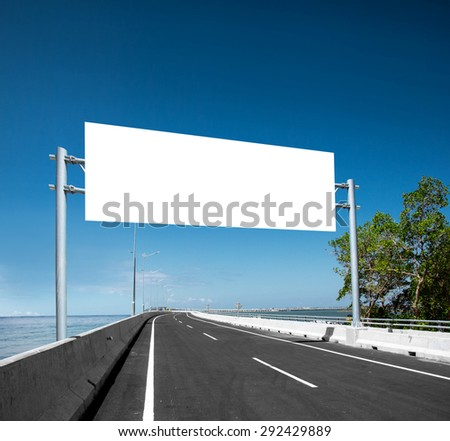 Blank White Blank board or billboard or roadsign in the road under the bright blue sky
