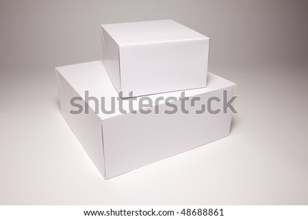 Blank White Box Isolated on a Grey Background Ready for Your Own Graphics. - stock photo