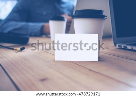 Blank White Business Card Mockup Wood Table Take Away Coffee Cup.Adult Businessman Work Modern Notebook Office Blurred Background.Clean Object Ready Private Corporate Information.Horizontal Mock Up