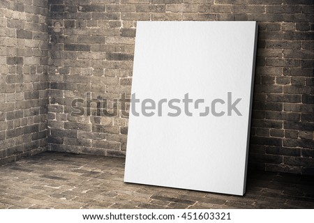 Blank white canvas frame leaning at grunge brick room, Mock up template for adding your design or content
