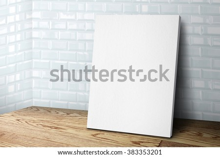 Blank white canvas frame leaning at tile wall and wood floor, Mock up template for adding your design.