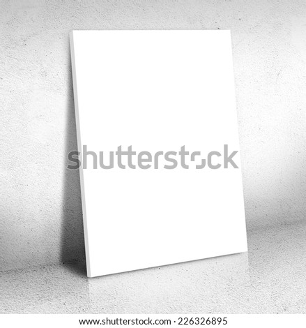Blank white Canvas poster leaning at White cement room, Mock up for add your content,business presentation template - stock photo