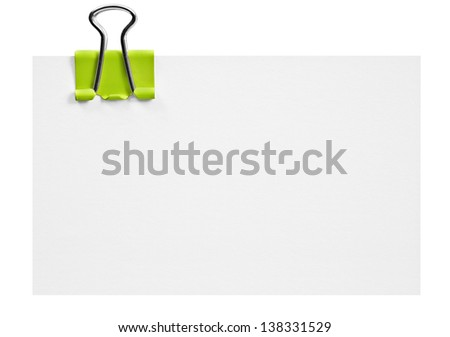 Blank white card with green clip on white - stock photo
