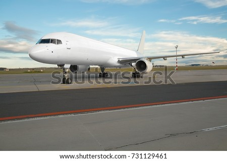 Blank white cargo plane at an airport