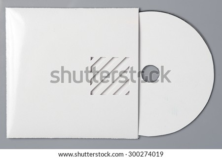 blank white compact disk with cover isolated on grey - stock photo