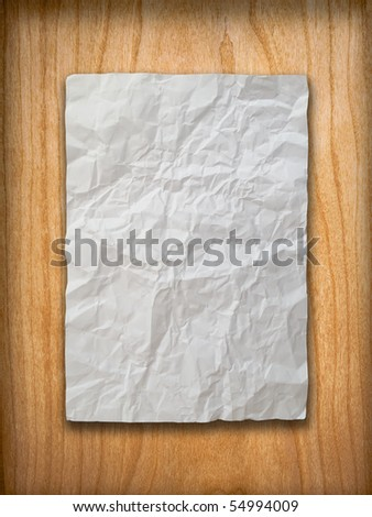 Blank White Crumpled paper on wood wall