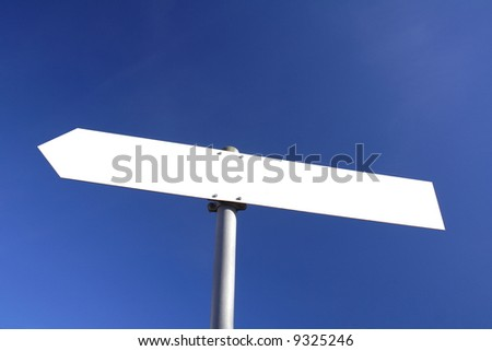 blank white direction board with blue sky in the background - stock photo