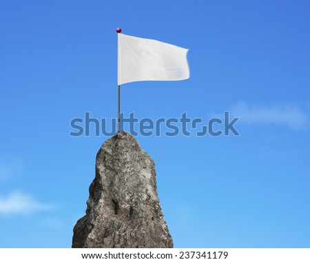 blank white flag on the mountain peak with natural sky cloud background  - stock photo