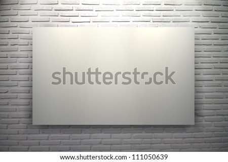 Blank white frame on white brick wall background with spot lights in museum - stock photo