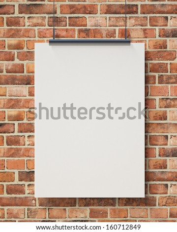 blank white hanging poster on brick wall, background - stock photo