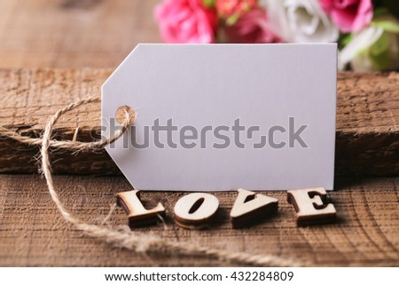 Blank white label with wooden love aside for Valentine day background. - stock photo