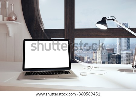 Blank white laptop screen on the table in the office with round window at sunrise, mock up 3D Render - stock photo