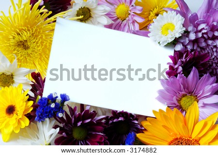 Blank white note-card with assorted springtime flowers