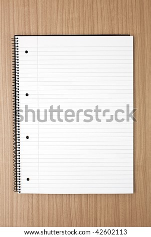 blank white notebook on table - stock photo